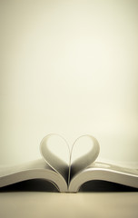 Opened book with heart page