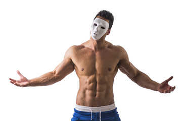 Shirtless muscle man with creepy, scary mask on tilted head