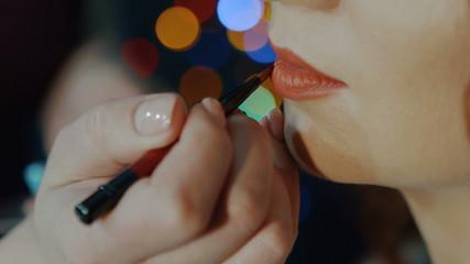 Makeup Applying. Professional Make-up. Lipgloss brush. Lipstick