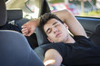 Young man sleeping inside his car, exhausted - 82391730