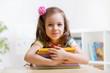 Leinwanddruck Bild - Cute child girl preschooler with books