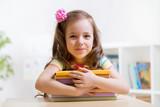 Fototapety Cute child girl preschooler with books