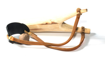 Wooden catapult slingshot isolated on white background