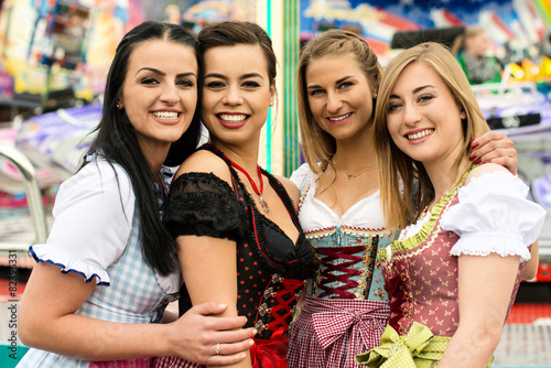 4 gorgeous young women at German funfair - 82396331