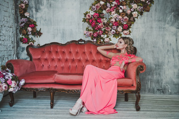 The girl in a pink dress on a sofa 2526.