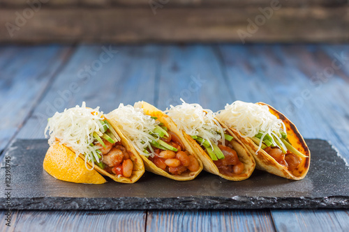 Spoed canvasdoek 2cm dik Voorgerecht Mexican tacos with meat, beans, avocado, cheese and tomato sauce