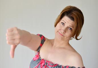 angry young woman showing thumb down