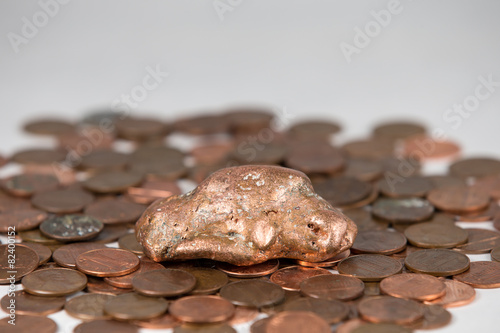 Copper Nugget and Pennies with Selective Focus on the Nugget