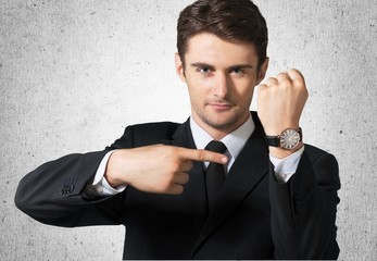 Watch. Businessman showing the time on his wrist watch