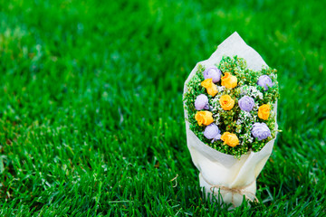 Wedding bouquet of roses lying on grass