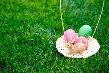 basket of Easter eggs in a field