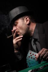 Male gambler playing poker.