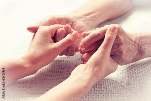 Care is at home of elderly. Hands senior man and caregiver. - 82406568