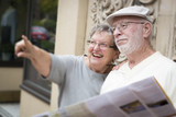 Tourist Senior Couple Looking at Brochure Map