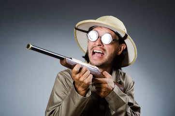 Funny safari hunter with rifle