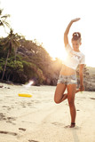 happy stylish sexy woman posing in summer on beach