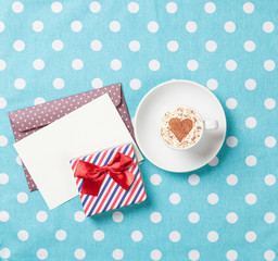 cappuccino and envelope with gift box