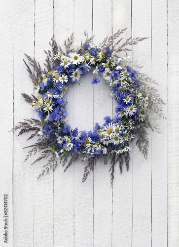 Wreath of flowers on the wooden background - 82414702