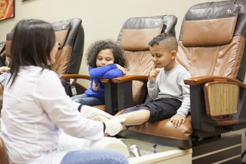 young children at the beauty spa getting pedicures