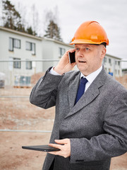 Engineer and house construction site