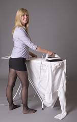 Woman standing at ironing board