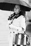 Beautiful fashion woman with umbrella in the rain