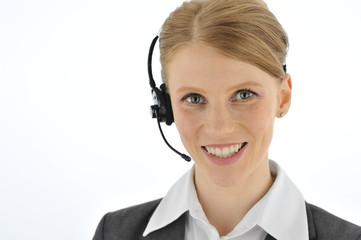 Professional smiling telephone operator