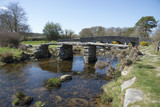 Ancient Clapper bridge at Postbrige on Dartmoor Devon UK - 82421716