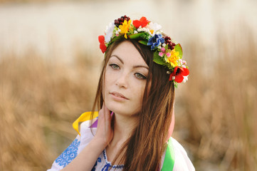 Ukrainian girl in the Ukrainian national clothes and with a wrea