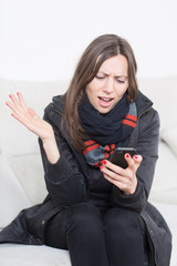 angry woman looking at cell phone