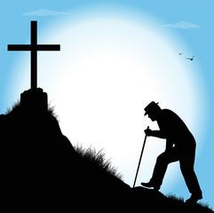 silhouette di anziano che cammina verso una croce