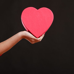 Woman hand holding heart box.
