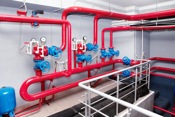 Red pipeline with manometers and blue gauges.