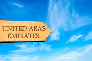 Wooden arrow sign pointing destination UNITED ARAB EMIRATES