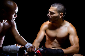 Trainer motivating a muscular Boxer or MMA fighter