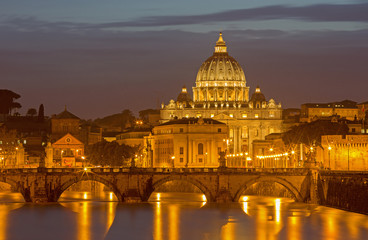 Rome - Angels bridge and St. Peters basilica in evening dusk