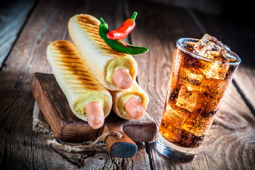 Grilled hot dog with cold drink