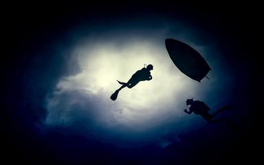 Freediver gliding underwater