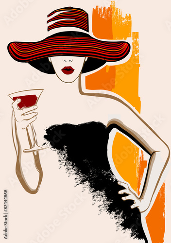 Pretty woman with large hat having cocktail - 82444969