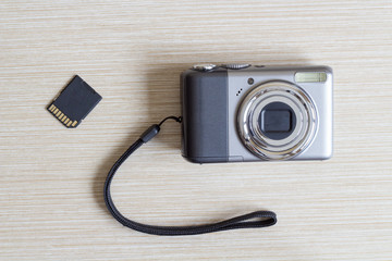 Digital photo camera and SD card.