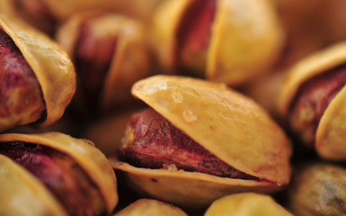 Fresh salted pistachios abstract background