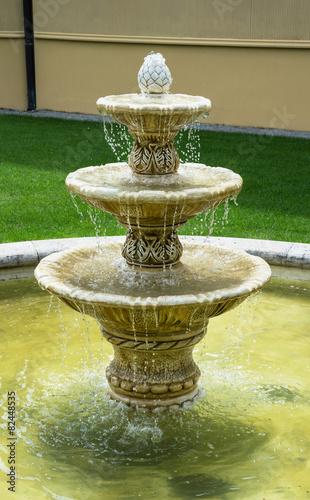 Leinwanddruck Bild Small fountain
