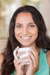 Pretty brunette holding her mug