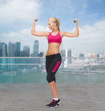 young sporty woman with dumbbells