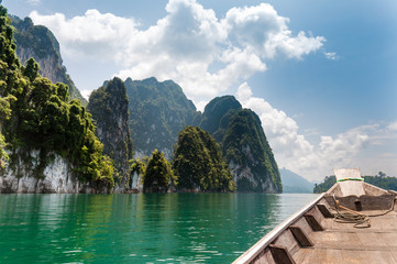 Limestone rock and Longtail boat at Cheow Lan Lake, Thailand