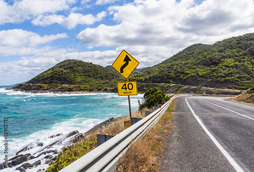 The yellow signs on the great ocean road - 82462713