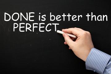 Done is Better Than Perfect  written on a blackboard