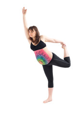 Pregnant woman with painted belly doing yoga exercise