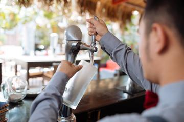 Filling mug with draft beer