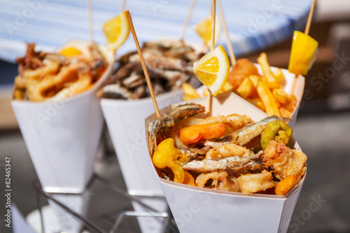 Foto op Canvas Vis Sea food in cones on the street of Italy